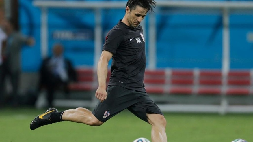 Croatia's head coach Niko Kovac kicks a ball during an official training session the day before the group A World Cup soccer match between Cameroon and Croatia, at the Arena da Amazonia in Manaus, Brazil, Tuesday, June 17, 2014. (AP Photo/Fernando Llano)