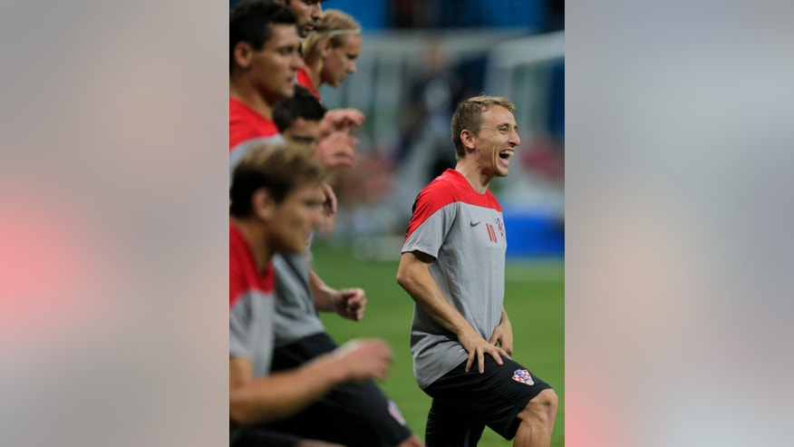 Croatia's Luka Modric, right, laughs during an official training session the day before the group A World Cup soccer match between Cameroon and Croatia, at the Arena da Amazonia in Manaus, Brazil, Tuesday, June 17, 2014. (AP Photo/Fernando Llano)