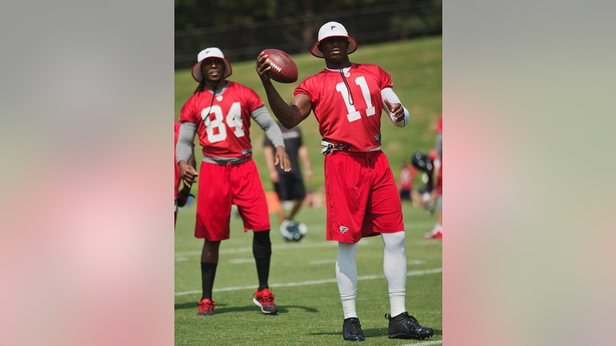 Atlanta Falcons' Roddy White, left, and Julio Jones stand on the field during the team's NFL mini-camp football practice, Tuesday, June 17, 2014, in Flowery Branch, Ga. (AP Photo/David Goldman)