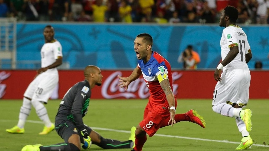 United States' Clint Dempsey turns away and celebrates after scoring the opening goal during the group G World Cup soccer match between Ghana and the United States at the Arena das Dunas in Natal, Brazil, Monday, June 16, 2014.  (AP Photo/Ricardo Mazalan)
