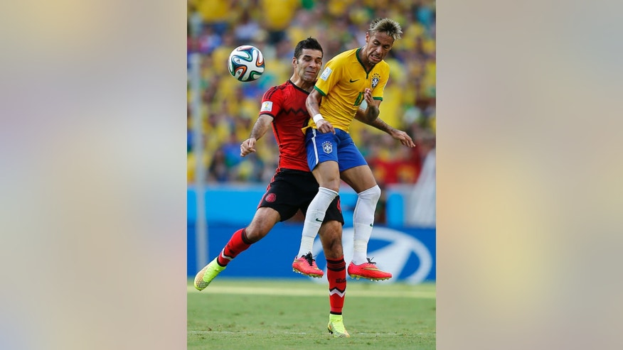 Mexico's Rafael Marquez, left, collides with Brazil's Neymar during the group A World Cup soccer match between Brazil and Mexico at the Arena Castelao in Fortaleza, Brazil, Tuesday, June 17, 2014.  (AP Photo/Eduardo Verdugo)
