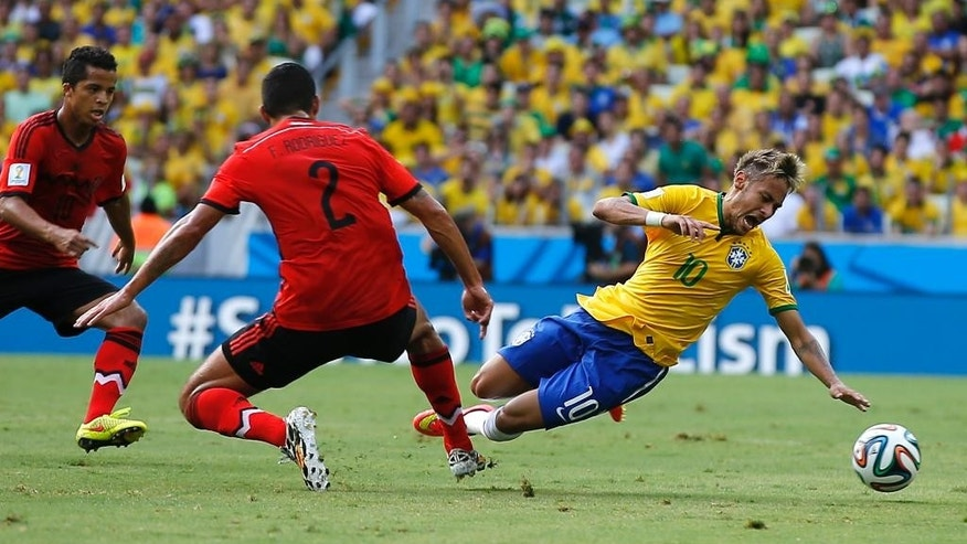 Brazil's Neymar (10) is tripped by Mexico's Francisco Rodriguez (2) during the group A World Cup soccer match between Brazil and Mexico at the Arena Castelao in Fortaleza, Brazil, Tuesday, June 17, 2014.  (AP Photo/Eduardo Verdugo)