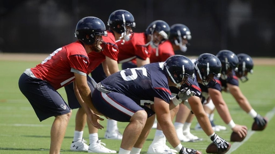 Houston Texans quarterbacks, from left, Ryan Fitzpatrick, Case Keenum,  T.J. Yates, and Tom Savage perform a drill during NFL football minicamp, Tuesday, June 17, 2014, in Houston. (AP Photo/Patric Schneider)