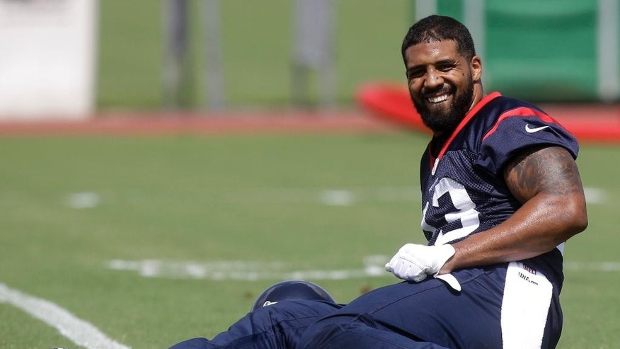 Houston Texans running back Arian Foster stretches during NFL football minicamp, Tuesday, June 17, 2014, in Houston. (AP Photo/Patric Schneider)