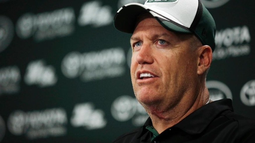 New York Jets head coach Rex Ryan answers a question during a news conference after a workout at NFL football mini camp Tuesday, June 17, 2014, in Florham Park, N.J. (AP Photo/Mel Evans)