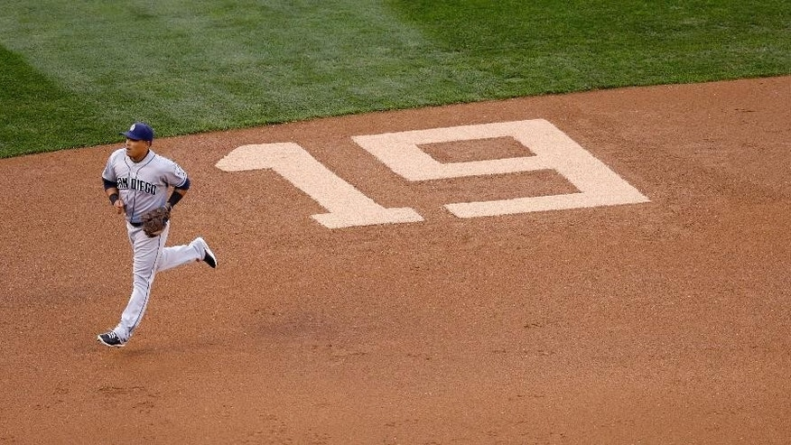 "San Diego Padres shortstop Everth Cabrera runs past a number ""19"" etched into the infield to honor former Padres' Tony Gwynn in the first inning during a baseball game against the Seattle Mariners Monday, June 16, 2014, in Seattle. It was announced earlier Monday that Gwynn, who had more than 3,100 hits during a career spanning two decades, died at age 54 following a battle with oral cancer. (AP Photo/Elaine Thompson)"