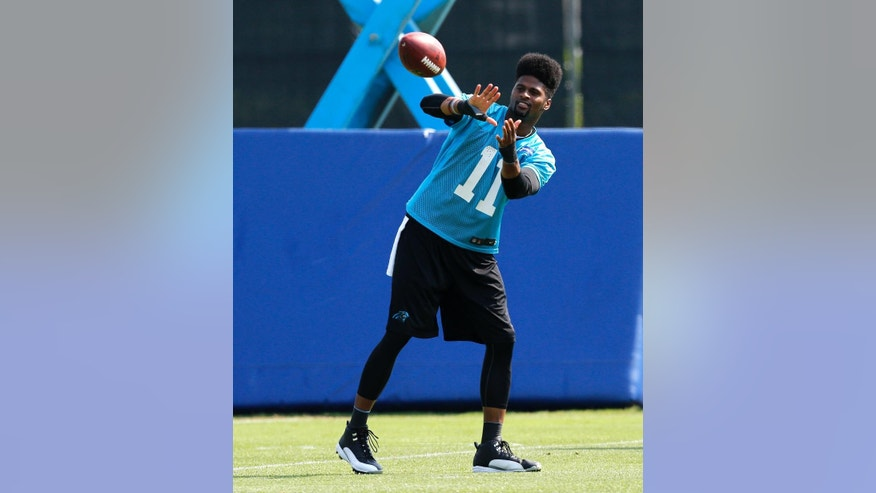 Carolina Panthers wide receiver Tiquan Underwood catches a pass during NFL football practice in Charlotte, N.C. on Tuesday, June 17, 2014.  (AP Photo/Nell Redmond)