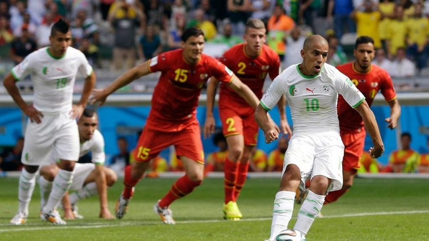 Algeria's Sofiane Feghouli scores the opening goal from the penalty spot during the group H World Cup soccer match between Belgium and Algeria at the Mineirao Stadium in Belo Horizonte, Brazil, Tuesday, June 17, 2014.   (AP Photo/Ricardo Mazalan)