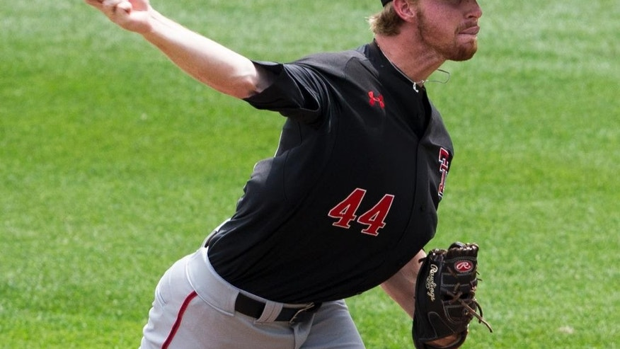Texas Tech pitcher Ryan Moseley delivers against Mississippi in the first inning of an elimination baseball game at the NCAA College World Series in Omaha, Neb., Tuesday, June 17, 2014. (AP Photo/Nati Harnik)