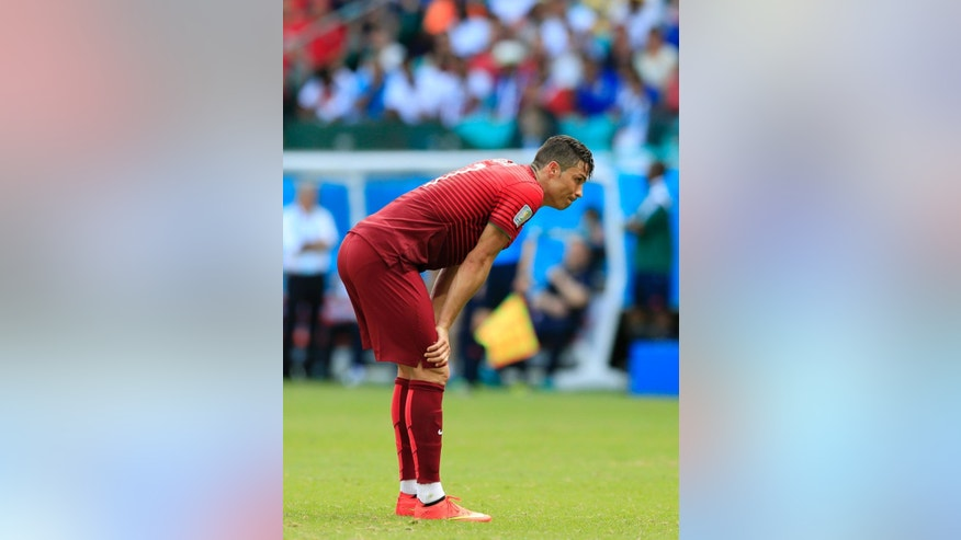 Portugal's Cristiano Ronaldo bends over during the group G World Cup soccer match between Germany and Portugal at the Arena Fonte Nova in Salvador, Brazil, Monday, June 16, 2014.  (AP Photo/Bernat Armangue)