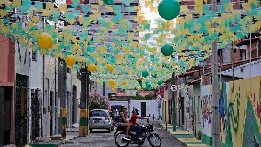 An alley is decorated with the colors of the Brazilian flag during the 2014 soccer World Cup in Fortaleza, Brazil, Monday, June 16, 2014.  (AP Photo/Marcio Jose Sanchez)