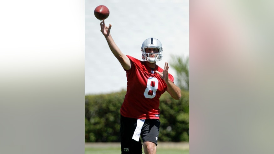 Oakland Raiders quarterback Matt Schaub passes during a drill at the Raiders mini-camp in Alameda, Calif., Wednesday, June 18, 2014.  Schaub was acquired by the Raiders from the Houston Texans for a sixth-round pick in the 2014 draft. (AP Photo/Rich Pedroncelli)