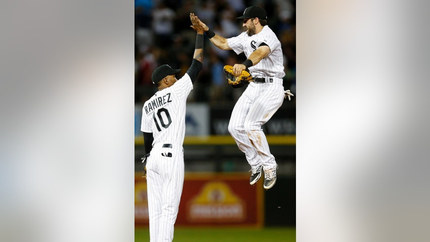 Chicago White Sox center fielder Adam Eaton, right, and shortstop Alexei Ramirez, left, celebrate after defeating the San Francisco Giants 8-2 in a baseball game on Tuesday, June 17, 2014, in Chicago. (AP Photo/Andrew A. Nelles)