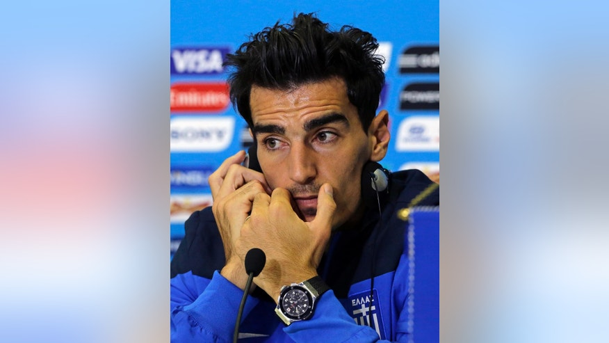 Greece's Lazaros Christodoulopoulos speaks during a press conference of Greece in Natal, Brazil, Wednesday, June 18, 2014.  Greece play in group C of the 2014 soccer World Cup. (AP Photo/Shuji Kajiyama)