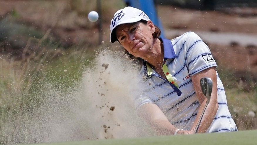 Juli Inkster chips to the 10th green during a practice round for the U.S. Women's Open golf tournament in Pinehurst, N.C., Wednesday, June 18, 2014. (AP Photo/Bob Leverone)