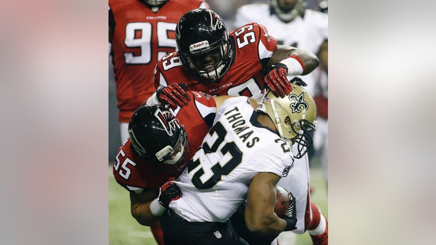 FILE - In this Nov. 21, 2013, file photo, New Orleans Saints running back Pierre Thomas (23) is hit by Atlanta Falcons linebackers Joplo Bartu (59) and Paul Worrilow (55) during the first half of an NFL football game in Atlanta.  Sean Weatherspoon's season-ending Achilles injury will put even more responsibility on Worrilow and Bartu.  (AP Photo/David Goldman, File)