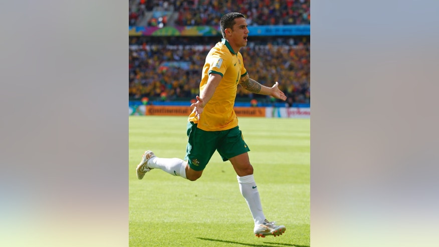 Australia's Tim Cahill celebrates after scoring his side's first goal during the group B World Cup soccer match between Australia and the Netherlands at the Estadio Beira-Rio in Porto Alegre, Brazil, Wednesday, June 18, 2014.   (AP Photo/Wong Maye-E)