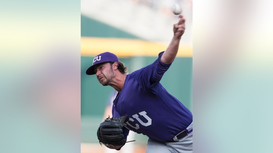 TCU pitcher Brandon Finnegan delivers against Virginia in the first inning of an NCAA baseball College World Series game in Omaha, Neb., Tuesday, June 17, 2014. (AP Photo/Nati Harnik)