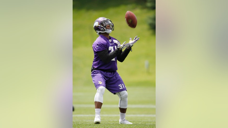 Minnesota Vikings Jerick McKinnon catches a pass during an NFL mini camp in Eden Prairie, Minn., Tuesday, June 17, 2014. The Vikings are hoping McKinnon's versatility and speed can provide a productive complement to Adrian Peterson in the backfield this season. (AP Photo/Ann Heisenfelt)