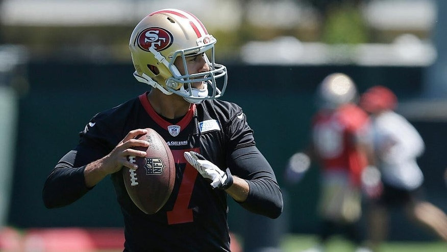 San Francisco 49ers quarterback Colin Kaepernick passes during NFL football minicamp in Santa Clara, Calif., Thursday, June 19, 2014. (AP Photo/Jeff Chiu)