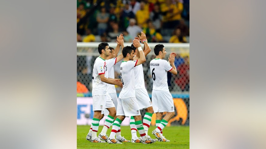 Iranian players applaud spectators following their 0-0 tie with Nigeria during the group F World Cup soccer match between Iran and Nigeria at the Arena da Baixada in Curitiba, Brazil, Monday, June 16, 2014.  (AP Photo/Frank Augstein)