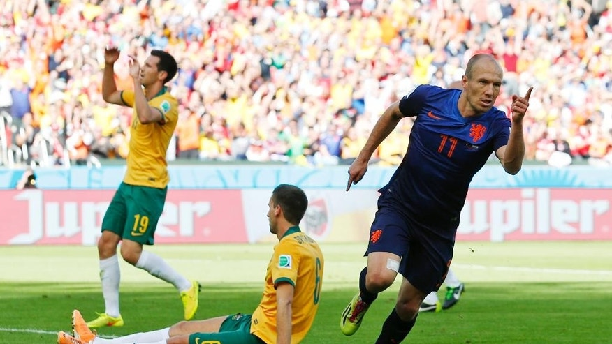 Netherlands' Arjen Robben (11) celebrates after scoring his side's first goal during the group B World Cup soccer match between Australia and the Netherlands at the Estadio Beira-Rio in Porto Alegre, Brazil, Wednesday, June 18, 2014. (AP Photo/Jon Super)