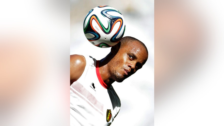 Belgium's Vincent Kompany plays with the ball during a training session at the Mineirao Stadium in Belo Horizonte, Brazil, Monday, June 16, 2014.  Belgium will play in group H of the Brazil 2014 soccer World Cup. (AP Photo/Bruno Magalhaes)
