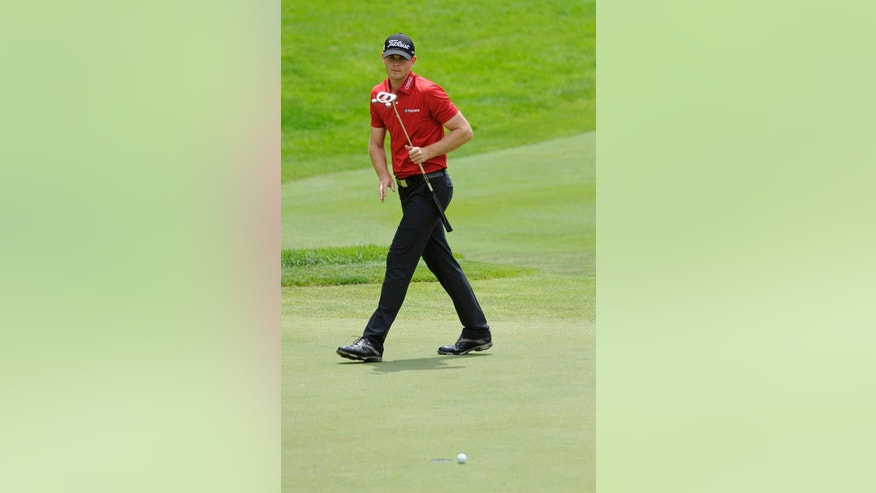 Brendan Steele watches his birdie putt miss on the 18th hole during the first round of the Travelers Championship golf tournament in Cromwell, Conn., Thursday, June 19, 2014. Steele finished the round at 8-under par, 62. (AP Photo/Fred Beckham)