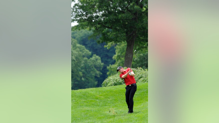 Brendan Steele hits his second shot on the 18th hole during the first round of the Travelers Championship golf tournament in Cromwell, Conn., Thursday, June 19, 2014. Steele finished his round at 8-under par, 62. (AP Photo/Fred Beckham)