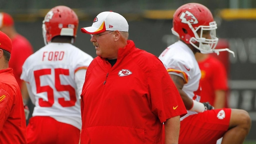 Kansas City Chiefs head coach Andy Reid watches his players during NFL football minicamp at the team's practice facility in Kansas City, Mo., Wednesday, June 18, 2014. (AP Photo/Colin E. Braley)