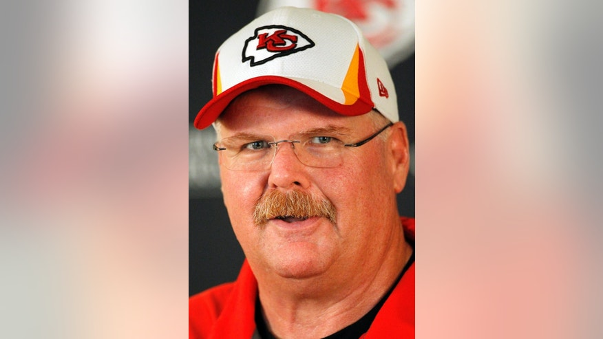 Kansas City Chiefs head coach Andy Reid talks about his team's progress at a press conference at the end of a three day NFL football minicamp at the team's practice facility in Kansas City, Mo., Thursday, June 19, 2014. (AP Photo/Colin E. Braley)