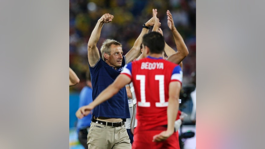 United States' head coach Juergen Klinsmann celebrates his team's 2-1 victory over Ghana during the group G World Cup soccer match between Ghana and the United States at the Arena das Dunas in Natal, Brazil, Monday, June 16, 2014. (AP Photo/Petr David Josek)