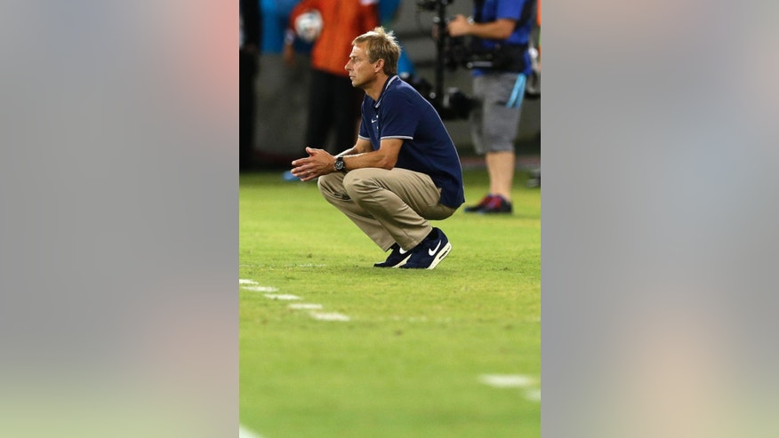 United States' head coach Juergen Klinsmann watches his team play from the technical area during the group G World Cup soccer match between Ghana and the United States at the Arena das Dunas in Natal, Brazil, Monday, June 16, 2014.  (AP Photo/Ricardo Mazalan)