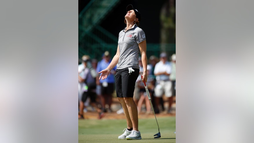 Juli Inkster reacts after missing a putt on the seventh hole during the first round of the U.S. Women's Open golf tournament in Pinehurst, N.C., Thursday, June 19, 2014. (AP Photo/John Bazemore)