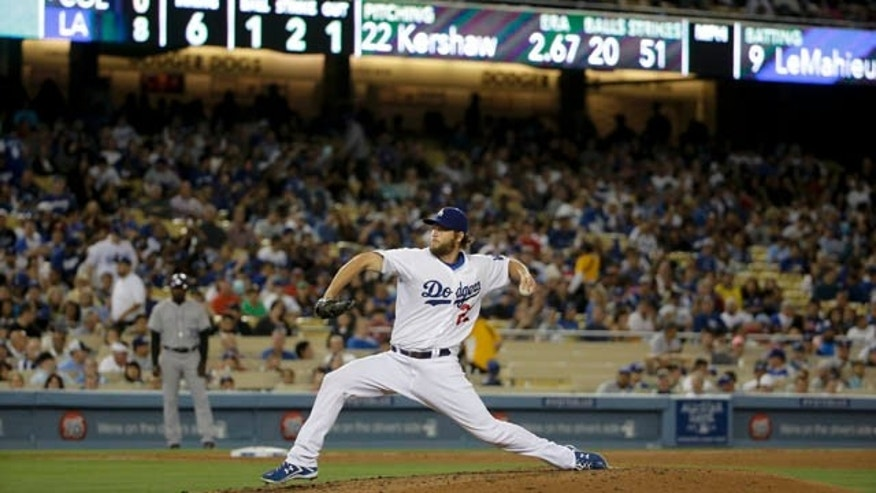 June 18, 2014: Los Angeles Dodgers starting pitcher Clayton Kershaw throws against the Colorado Rockies during sixth inning of a baseball game in Los Angeles. (AP Photo/Chris Carlson)
