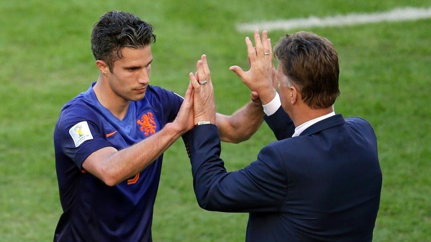 Netherlands' Robin van Persie, left, gives a high five to Netherlands' head coach Louis van Gaal after being substituted during the group B World Cup soccer match between Australia and the Netherlands at the Estadio Beira-Rio in Porto Alegre, Brazil, Wednesday, June 18, 2014.  (AP Photo/Michael Sohn)