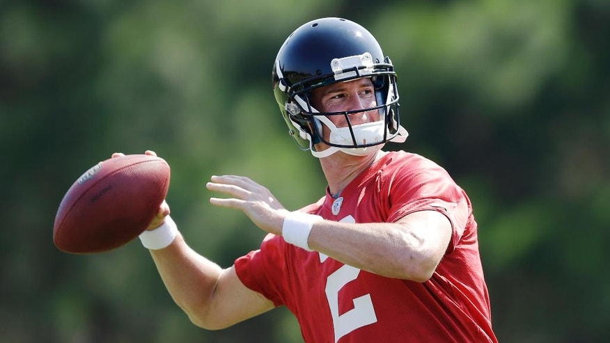 Atlanta Falcons quarterback Matt Ryan looks to throw the ball during NFL football minicamp, Thursday, June 19, 2014, in Flowery Branch, Ga. Entering his seventh season as the Falcons' starting quarterback, Ryan says he's comfortable behind a retooled offensive line after last year's 4-12 debacle. (AP Photo/David Goldman)