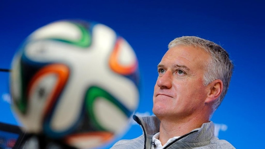 France's head coach Didier Deschamps attends a press conference, the day before the group E World Cup soccer match between France and Switzerland at the Arena Fonte Nova stadium in Salvador, Brazil, Thursday, June 19, 2014. (AP Photo/David Vincent)