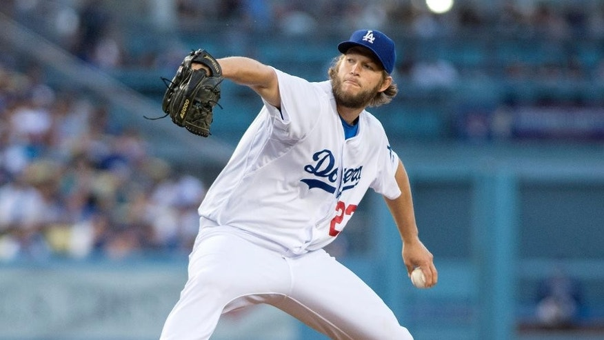 The Dodgers' Clayton Kershaw delivers a pitch during a game against the Rockies at Dodger Stadium on Wednesday June 18, 2014. Kershaw pitched his first no-hitter Wednesday night, striking out a career-high 15 and allowing his only baserunner on a throwing error by shortstop Hanley Ramirez in the Los Angeles Dodgers' 8-0 victory over the Colorado Rockies. (AP Photo/The Orange County Register, Kyusung Gong)
