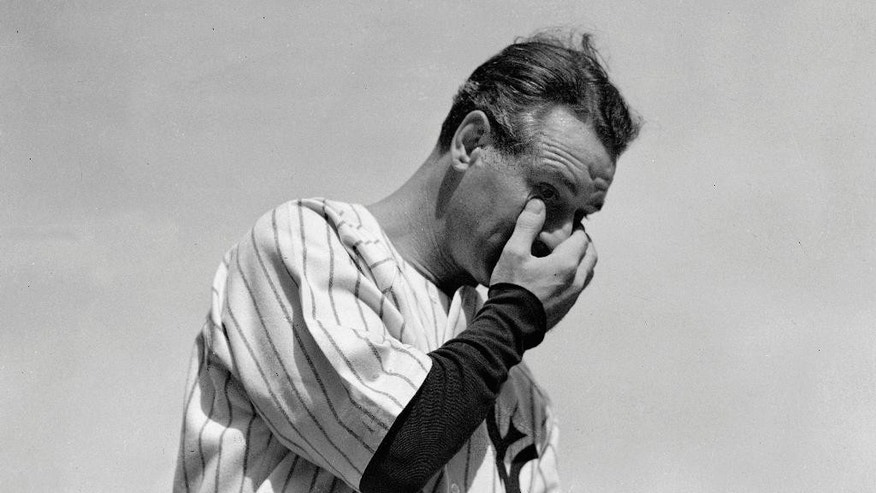 "FILE - In this July 4, 1939, file photo, New York Yankees' Lou Gehrig wipes away a tear while speaking during a tribute at Yankee Stadium in New York. The league will conduct special on-field ceremonies to commemorate the 75th anniversary of Gehrig's ""Luckiest Man"" speech and honor his legacy on July 4, 2014. Gehrig passed away on June 2, 1941 at the age of 37.  (AP Photo/Murray Becker, File)"