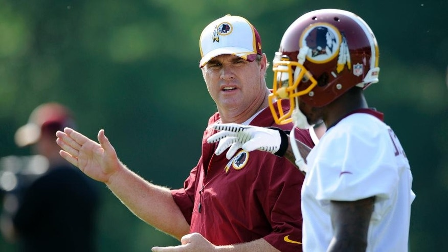 June 18, 2014: Washington Redskins head coach Jay Gruden, left, talks with wide receiver DeSean Jackson, right, during NFL football minicamp in Ashburn, Va. (AP)