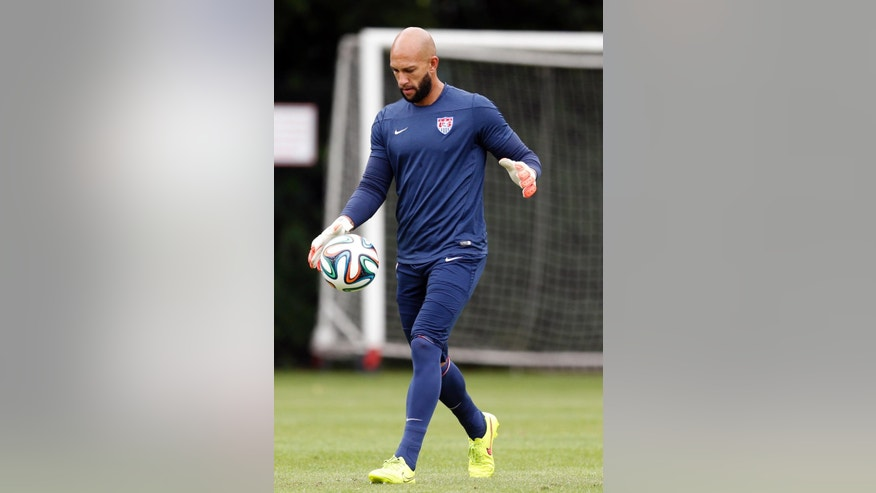 United States' Tim Howard works out during a training session in Sao Paulo, Brazil, Friday, June 20, 2014. The U.S. will play against Portugal in group G of the 2014 soccer World Cup on June 22. (AP Photo/Julio Cortez)