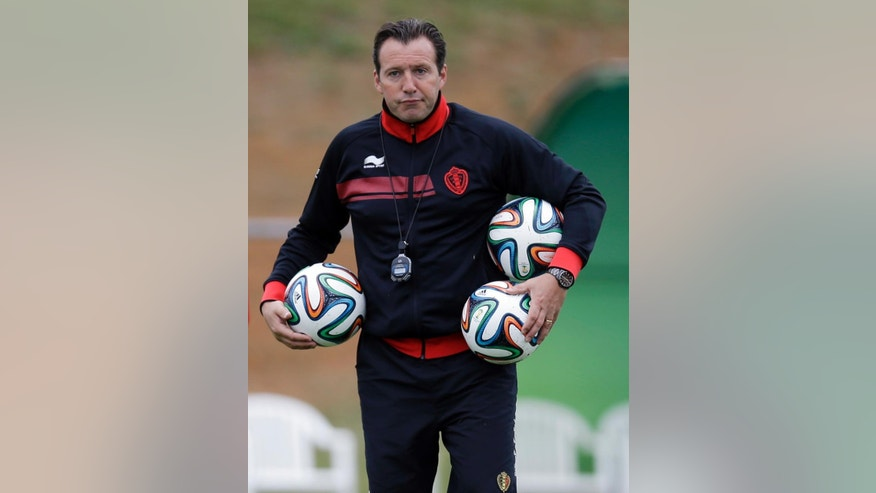 Belgium's head coach Marc Wilmots holds three balls during a training session of Belgium in Mogi Das Cruzes, Brazil, Thursday, June 19, 2014. Belgium play in group H of the 2014 soccer World Cup. (AP Photo/Andrew Medichini)