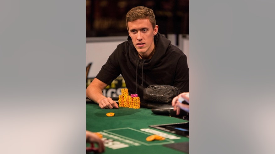 This June 18, 2014 photo provided by the World Series of Poker shows pro soccer player Max Kruse playing in the World Series of Poker at the Rio Casino in Las Vegas. Kruse, a German who was left off his country's World Cup team, placed third in his event and won $36,494 in prize money. (AP Photo/World Series of Poker, Melissa Haereiti)