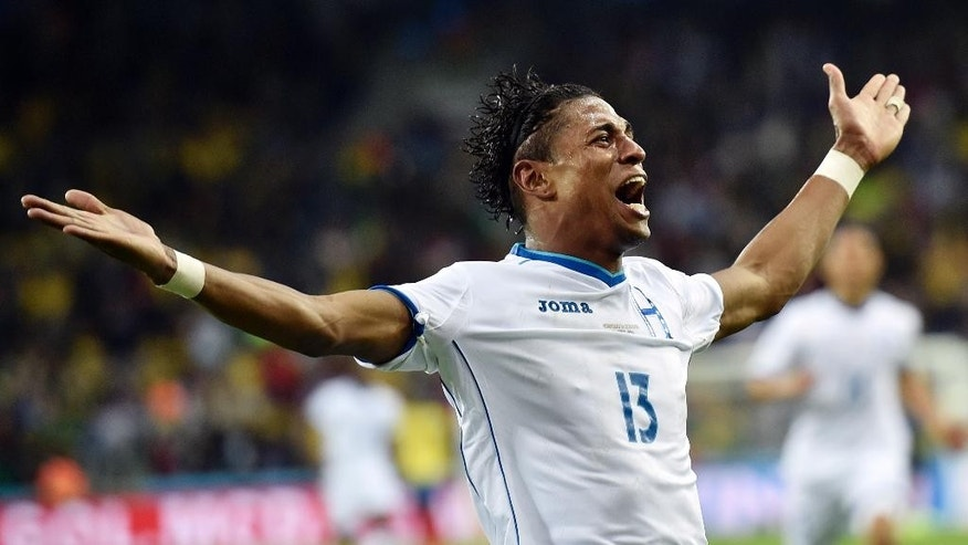 Honduras' Carlo Costly celebrates after scoring a goal during the group E World Cup soccer match between Honduras and Ecuador at the Arena da Baixada in Curitiba, Brazil, Friday, June 20, 2014.  (AP Photo/Martin Meissner)