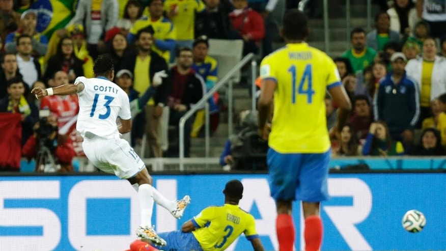 Honduras' Carlo Costly, left, kicks to score his side's first goal during the group E World Cup soccer match between Honduras and Ecuador at the Arena da Baixada in Curitiba, Brazil, Friday, June 20, 2014. (AP Photo/Fernando Vergara)