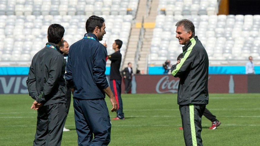 Iran's coach Carlos Queiroz, right, visits Mineirao stadium with his team in Belo Horizonte, Brazil, Friday, June 20, 2014. Iran plays in group F at the 2014 soccer World Cup. (AP Photo/Eugenio Savio)