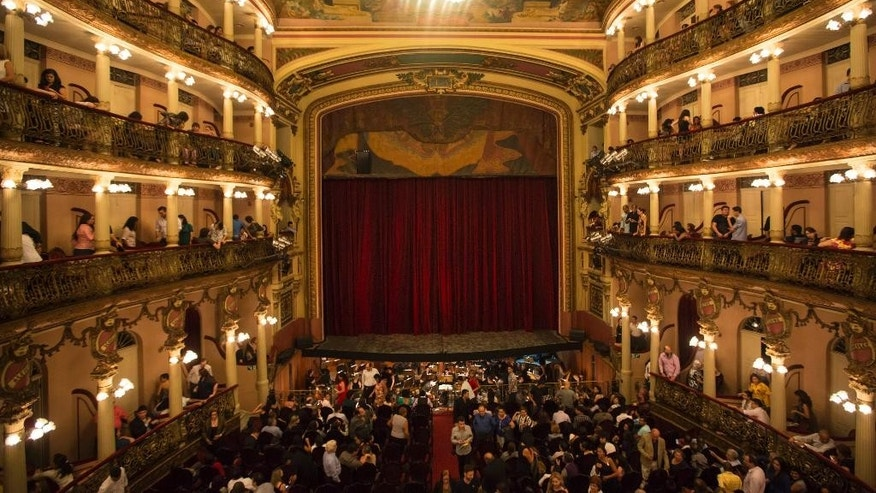 In this May 20, 2014 photo, people stand inside the Teatro Amazonas in Manaus, Brazil. The theater was a lavish vanity project of the rubber barons, whose plantations briefly catapulted Manaus into the ranks of the world's wealthiest cities in the late 19th century. (AP Photo/Felipe Dana)