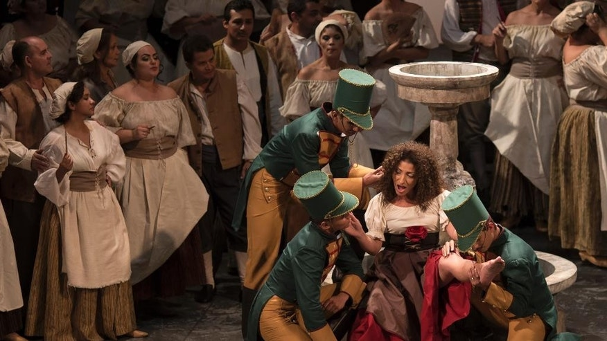 """In this May 20, 2014 photo, Cristina Gallardo-Domas performs in the opera """"Carmen"""" in the Teatro Amazonas in Manaus, Brazil.  """"It was like discovering a diamond in the Amazon rain forest,"""" said the Chilean-born soprano who recently played the title role in """"Carmen"""" to a packed, 689-seat house. (AP Photo/Felipe Dana)"""