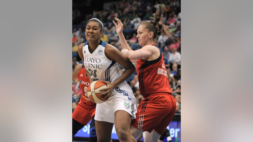 Washington Mystics center Emma Meesseman, right, pressures Minnesota Lynx forward Damiris Dantas, left, during the first quarter of a WNBA basketball game Friday, June 20, 2014, in Minneapolis. (AP Photo/Tom Olmscheid)